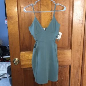 Teal dress with cutouts and lace up on side size s